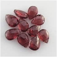 4 Garnet faceted pear drop briolette gemstone beads (N) Approximate size range 4.2 x 6mm to 5.5 x 6.9mm Top side drilled