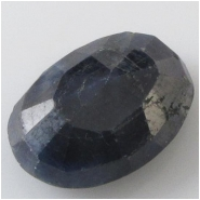 1 Sapphire blue faceted raised cabochon gemstone (N) Approximate size 13.7 x 19.3 x 7mm deep