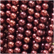 Pearl Iridescent Bordeaux Near Round Beads (D) Approximate size 7.24 to 8.63mm, 16 inches