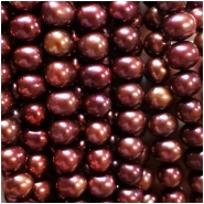 Pearl Iridescent Bordeaux Oval Beads (D) Approximate size 7.17 to 8.00mm x 7.84 to 9.74mm, 16 inches