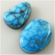 2 Turquoise Kingman cabochon gemstones (N) Approximate size 12.7 x 16.3mm and 10.5 x 14.9mm, 5.1 and 4.9mm deep